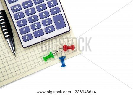 One Big Calculator And Stationery On A White Table Closeup