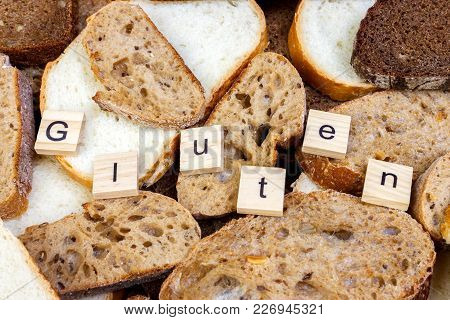 Gluten Text. Sliced Bread On The Top Of Table, Gluten Free Concept. Homemade Gluten Free Bread For P