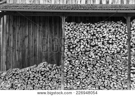 Black And White Photo Of Wood Logs Stock Pile Ready For Use In Germany Countryside