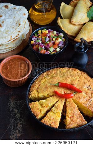Cornbread And Other Mexican Food - Tacos, Salsa With Tomato, Red Onion, Lime, Cilantro, Corn And Hot