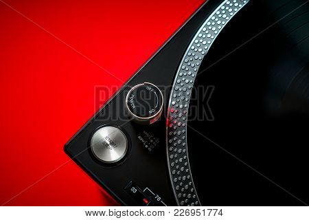 Closeup On A Modern Black Turntable On An Intense Red Background