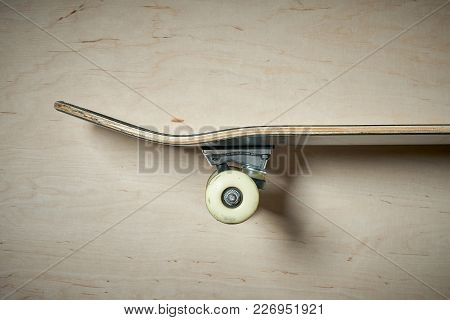 Top View Aside Of Skateboard On A Wooden Background