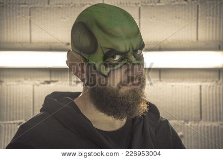 Leprechaun Make Up. Portrait Of A Leprechaun With A Beard. Portrait Of A Man. Green Make Up