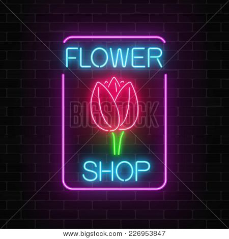 Glowing Neon Sign Of Floral Shop In Rectangle Frame On Dark Brick Wall Background. Design Of Flower