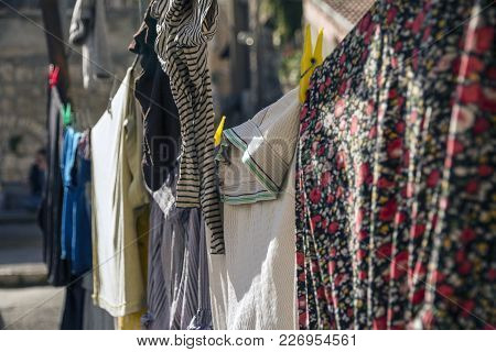 Colorful Clothes Hanging To Dry On A Laundry Line In A Sunny Day In Jerusalem, Israel
