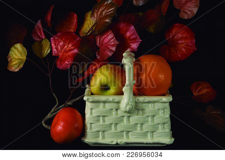 Fruit And Ancient Pottery. Reproduction Of A Basket In Ceramic To Contain Food.