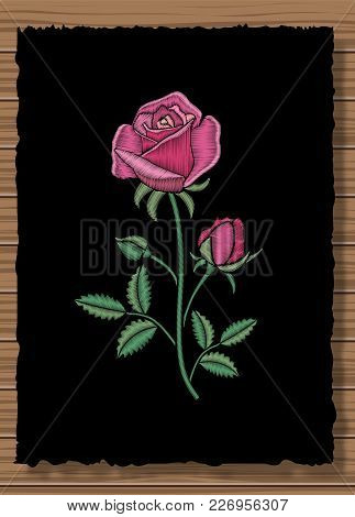 Floral Stitched Ornament With Stitch Rose. Embroidery Flower On A Dark Flap Cloth And Wooden Texture