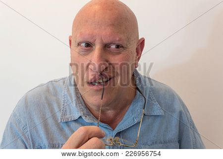 Creepy Older Man Holding Glasses With Eyes Looking To Side Holding Glasses To Lips, Bald, Alopecia,