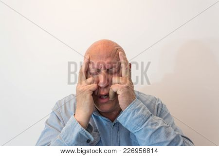 Older Man Hands To Temples In Pain, Bald, Alopecia, Chemotherapy, Cancer, Isolated On White, Vertica
