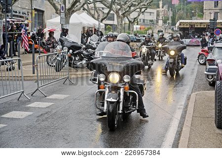 Beaucaire, France - April 30, 2016: Bikers Driving In Heavy Rain For A Gathering Of American Motorcy
