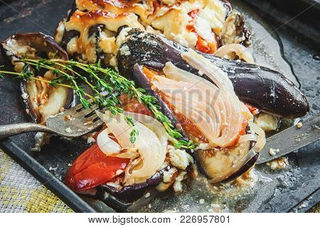 Close-up Of Stuffed Aubergines, Tomatoes, Meat And Onion With Sauce On The Dish. Art. The Horizontal