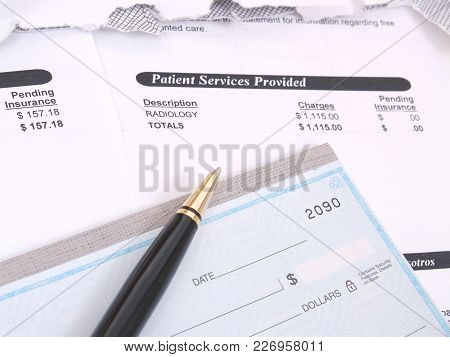 A Background Of A Medical Bill And Checkbook.