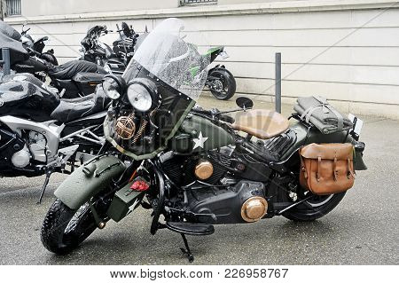 Beaucaire, France - April 30, 2016: A Motorcycle In The Style Army Stationed At A Gathering Of Ameri