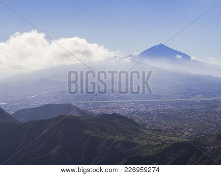 Blue Summit Of Volcano Pico Del Teide Highest Spanish Mountain In Clouds With View On La Orotava Cit