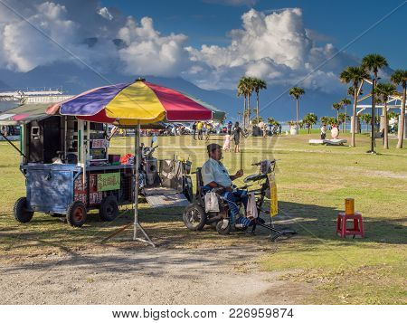 Hualien, Taiwan - October 16, 2016: The Man In The Wheelchair Is Playing  Percussion Near The Beach,