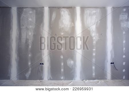 Wall Made From Plasterboard (drywall) And Prepared To Painting With Ladder In Apartment Is Under Con