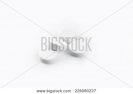 White Medical Pills Isolated On A White Background. Aspirin. Close-up. Copy Space. Still Life. Flat