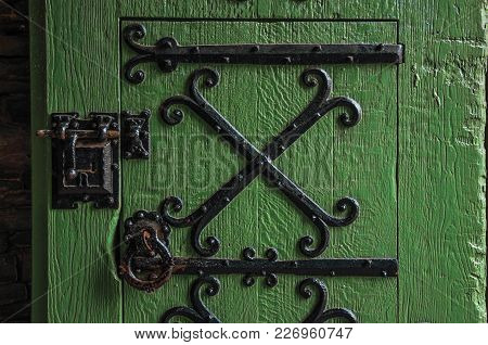Detail Of Lock And Hinge Of Iron On Wooden Door In Gravensteen Castle At Ghent. In Addition To Inten