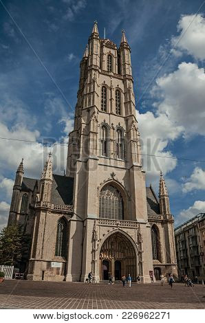 Ghent, Belgium - July 03, 2017. People, Gothic Cathedral And Blue Sky In Ghent. In Addition To Inten