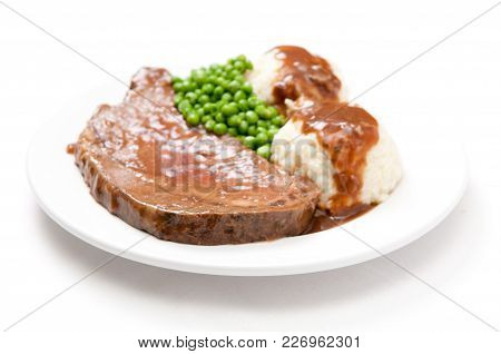 Roast Beef Dinner With Mashed Potatoes, Gravy And Fresh Vegetables