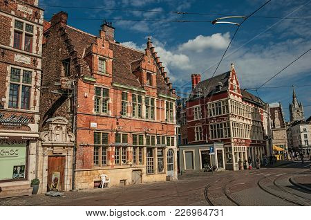 Ghent, Belgium - July 03, 2017. Street With Old Typical Building And Blue Sky In Ghent. In Addition