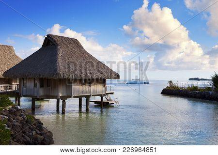 Catamaran And Wooden Hut At The Sea.