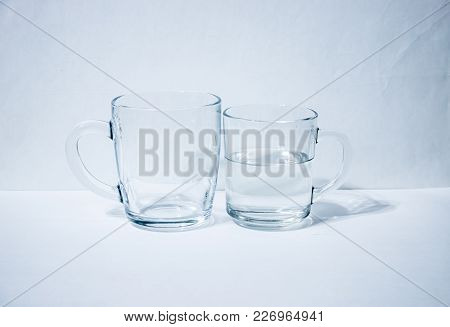 One Glass Empty Second With Water Light Background