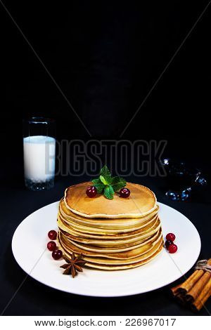 Delicious Breakfast Of Fresh Baked Pancakes On White Plate With Milk In Glass And Fresh Cranberry Ve