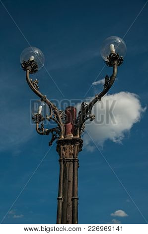 Close-up Of Cast Iron Lamp Post And Blue Sunny Sky In The City Center Of Ghent. In Addition To Inten