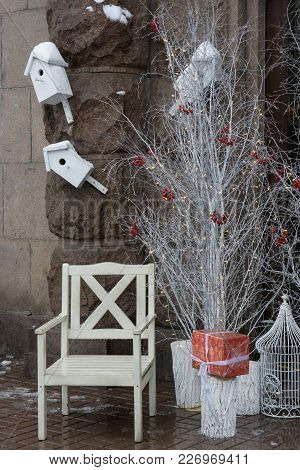 Humble Wooden White Santa Chair Near White Trees And Boxes With Presents. Cage For Holiday Bird. Ver