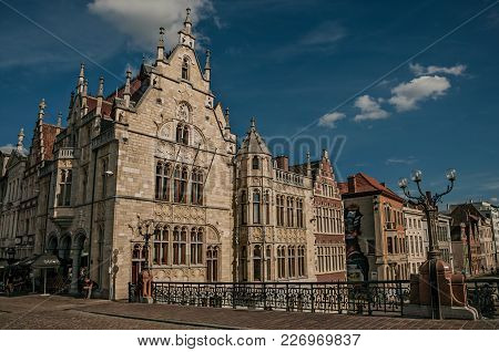 Ghent, Belgium - July 03, 2017. Old Buildings In Front Of The Canal And Bridge In Ghent. In Addition