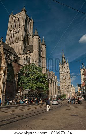 Ghent, Belgium - July 03, 2017. People, Old Buildings And Gothic Cathedral In Ghent. In Addition To