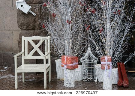 Humble White Santa Chair Near White Trees And Boxes With Presents. Cage For Holiday Bird
