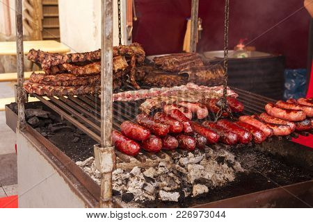 Meat Shop At The Market Sell Varied Kinds Of Beef, Pork, Deer, Goat And Bull Grilled Meat In Huesca,
