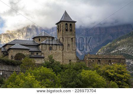 San Salvador Church In Torla, Next To Ordesa Y Monte Perdido National Park In The Valley Of Ordesa,