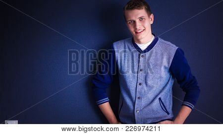 Portrait Of A Young Man On Black Background