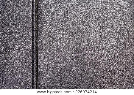 Texture Of A Surface From A Natural Skin Of Black Color With Single Seam With Double Stitch In Left