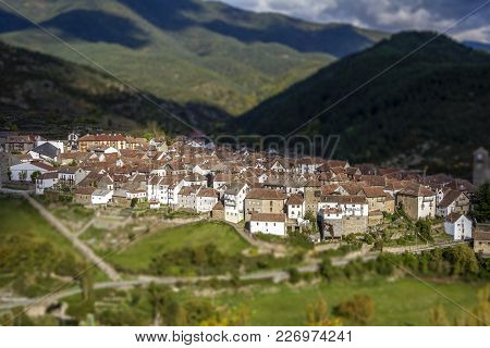 Beautiful Tilt Shift Effect Panoramic View Of Spanish Town In A Green Valley, Spain
