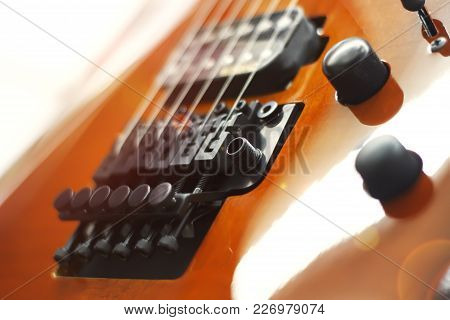 Electric Guitar Close-up With Soft Focus Of Brown Color, Floyd Rose.