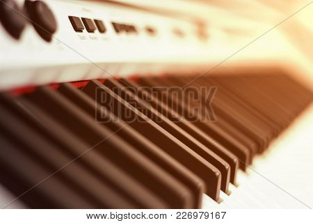 Closeup White Piano Keys, White Piano Isolated, Side View Of An Instrument. Learning To Play At Home