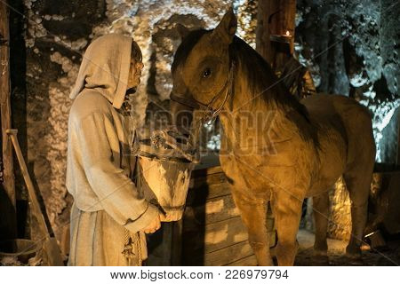 Wieliczka, Poland - May 28, 2016: Dummy Miner In The Wieliczka Salt Mine. Opened In The 13Th Century