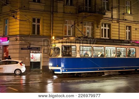Krakow, Poland - January 01, 2015: Tram Sgp/lohner E1 In The Historic Part Of Krakow In Night. Total