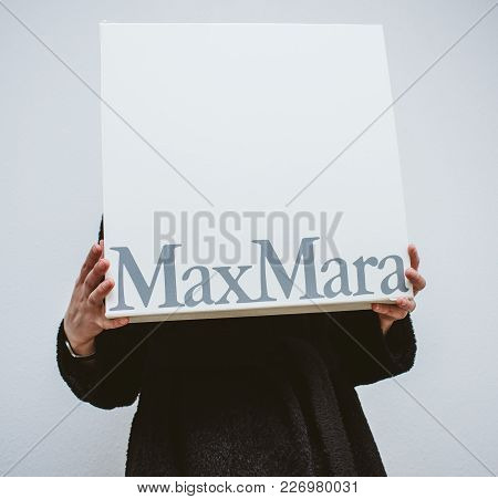 Paris, France - Feb 16, 2018: Beautiful Elegant Fashionista Woman Holding Max Mara Italian Cardboard