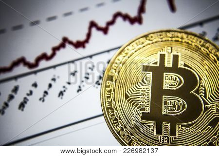 Bitcoin. Gold Bitcoin On The Background Of The Chart. Chart Bacground.