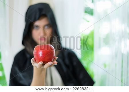 A Young Beautiful Witch With Red Apple.