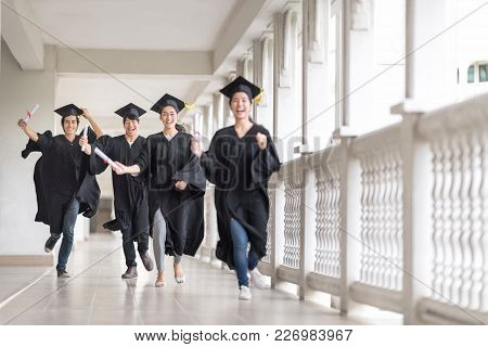 Graduation Day, Images Of Happily Graduates Are Celebrating Graduation, Graduate Are Running To Thei