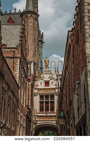 Rich And Elegant Decoration On The Historic Buildings At City Center Of Bruges. With Many Canals And