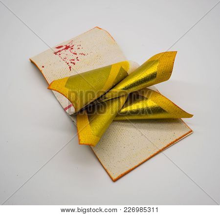Joss Paper Chinese Tradition For Passed Away Ancestor's Spirits, Isolated On White