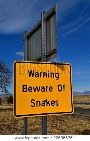 Sign Warning To Beware Of Snakes In The Area