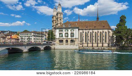 Zurich, Switzerland - 30 July, 2015: The Limmat River In The City Of Zurich, Munsterbrucke Bridge, O